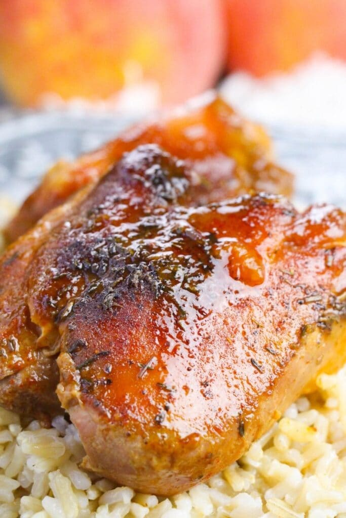 peach bbq chicken on plate with rice