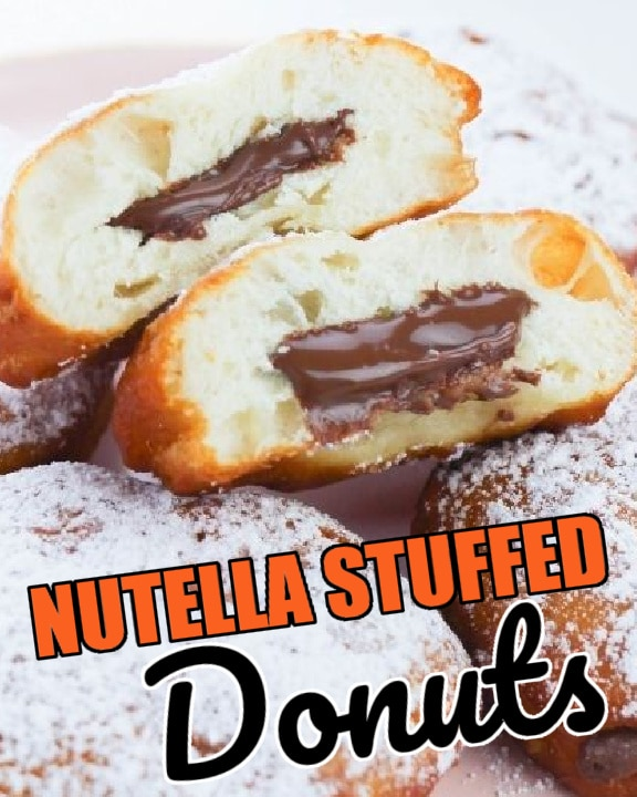nutella filled donuts on plate one cut in half