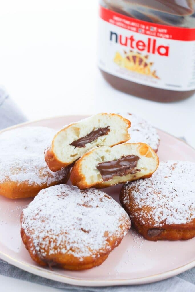 plate of donuts with Nutella in the back