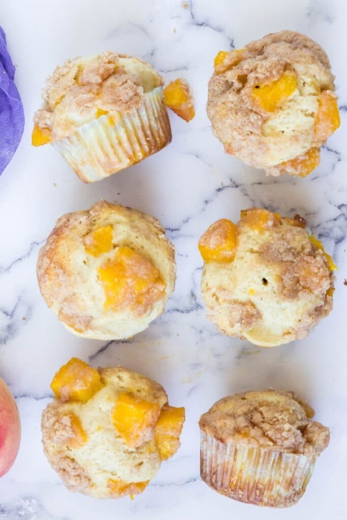 muffins on a marble counter in rows