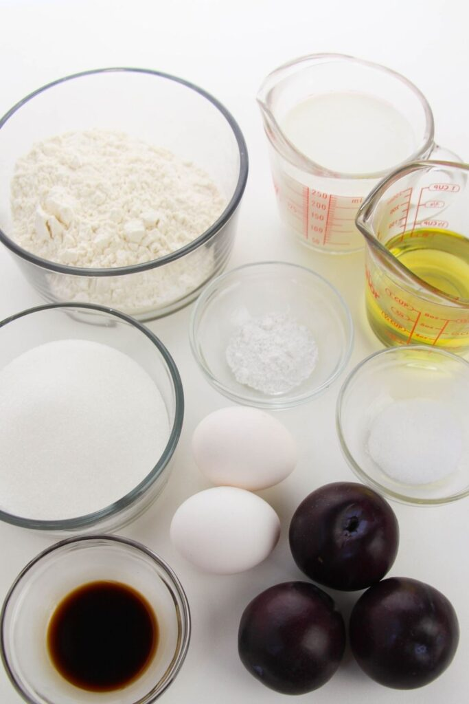 ingredients for sugar plum cupcakes in glass containers on white counter