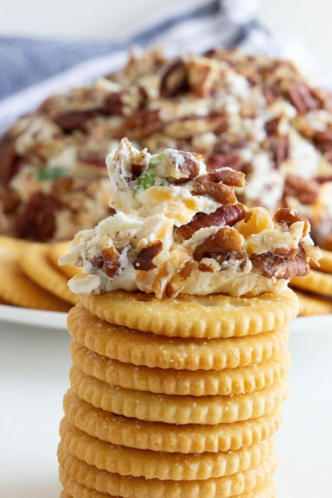 cheese ball dollop on top of a stack of crackers