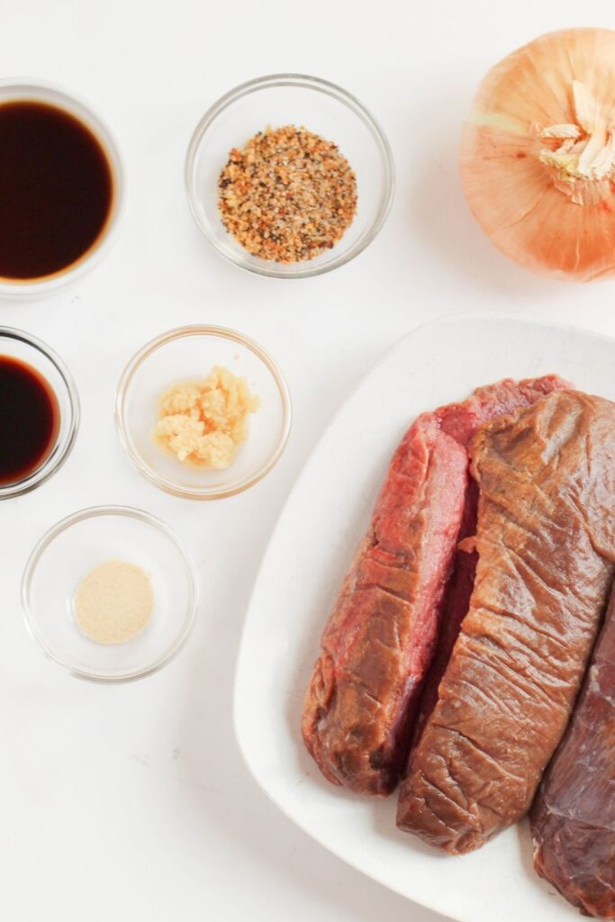 ingredients for deer roast on counter in glass bowls