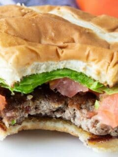smash burger with bite taken out