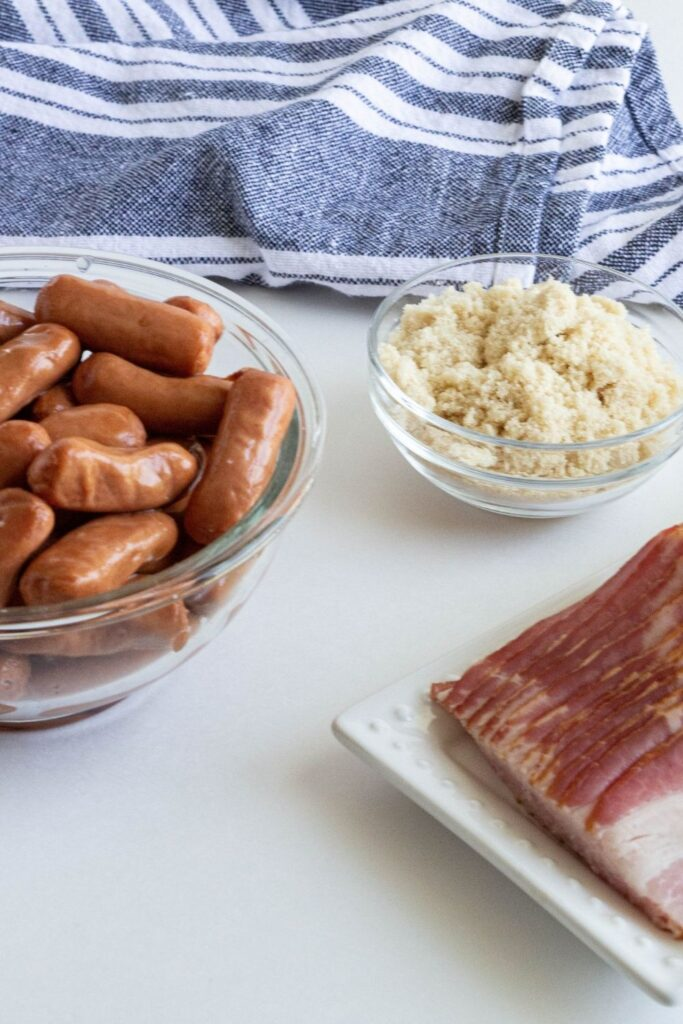 smokies, bacon and brown sugar sitting on counter in glass containers