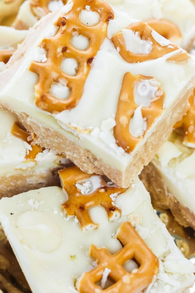sweetened condensed fudge with pretzels on top